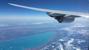 Lufthansa Boeing 747-8i left wing over a lake in the U.S.