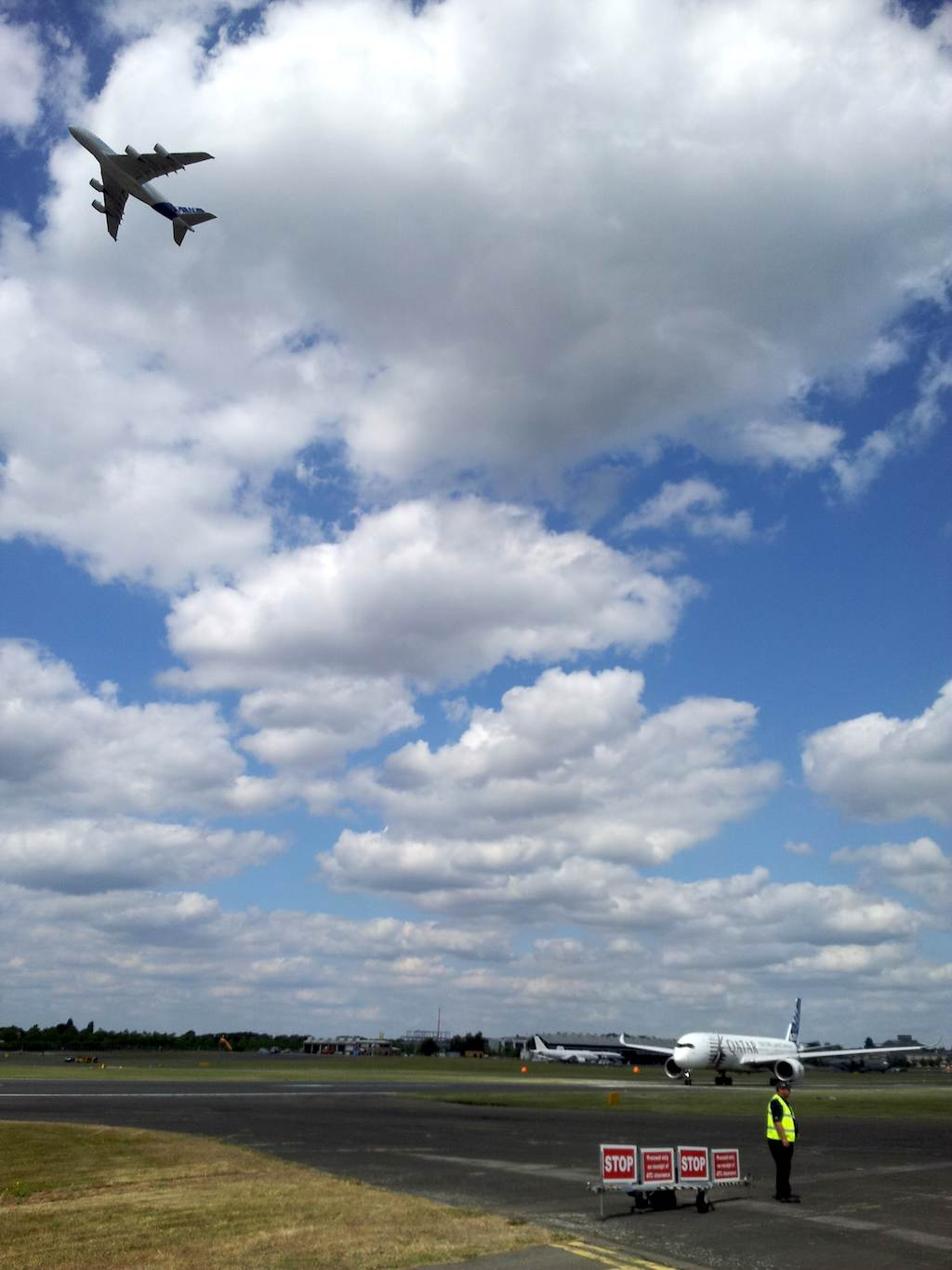 Airbus A380 flying and A350XWB Waiting to takeoff at Farnborough 2014