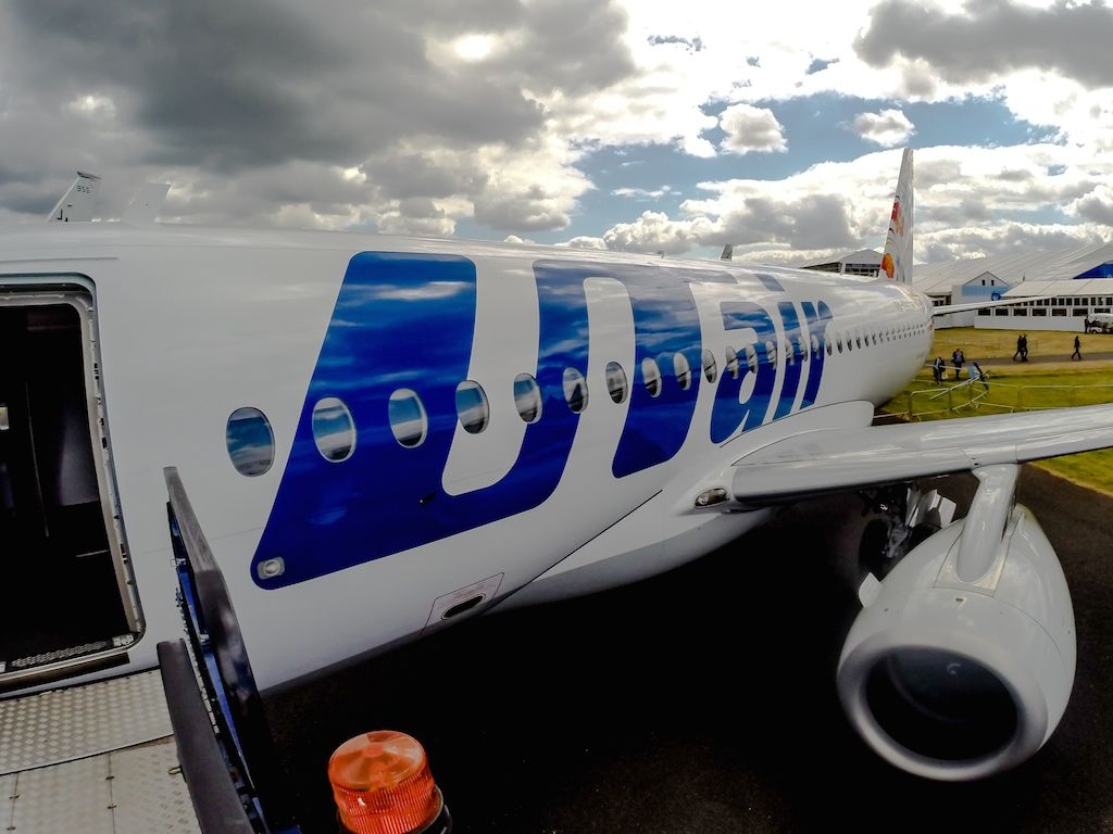 UTAir's Sukhoi SuperJet 100 at Farnborough 2014