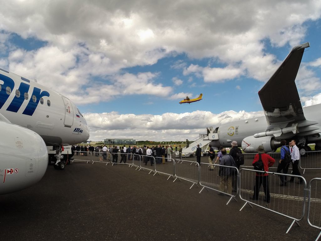 Flight Line with UTAir's SSJ100 and Boeing's P8 Poseidon at Farnborough 2014
