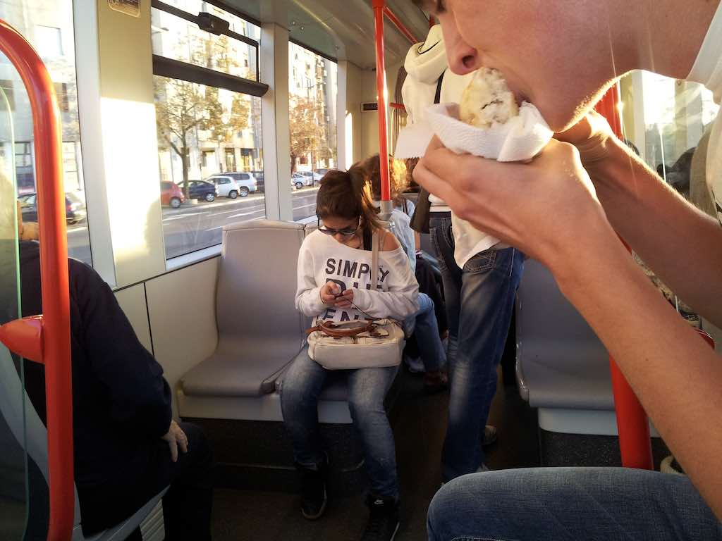Belgrade, Serbia - passenger eating a sandwich on the tram