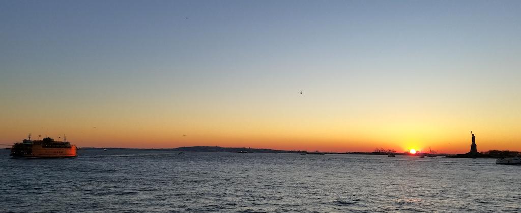 Staten Island Ferry, New York USA Sunset Statue of Liberty