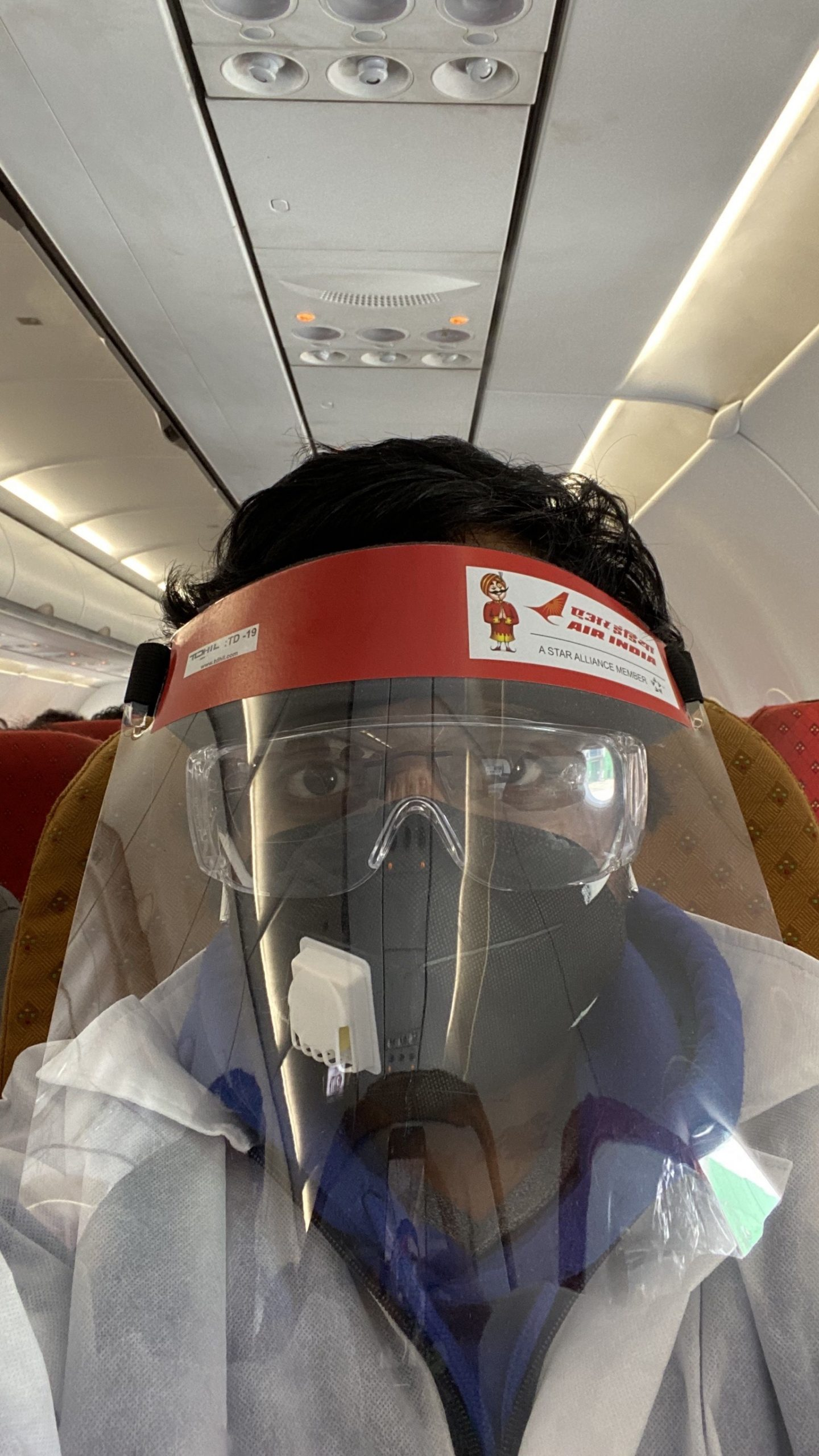 Ram Kumar - Repatriation flight hazmat suit, face shield and PPE